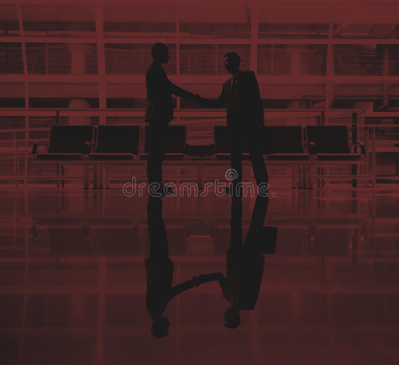Businessmen Talking Business Airport Deal Concept stock photography