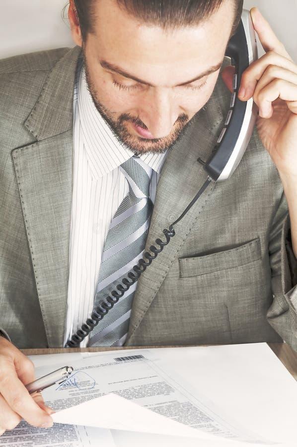 Businessmen talking on the phone