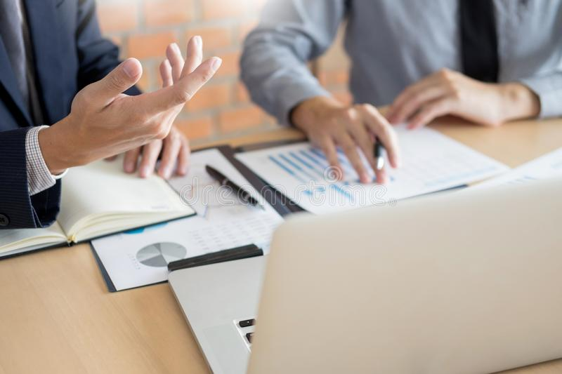 Businessmen talking about stock market invest trading online analysis discussing financial graph for investment purposes. Discussion in traders office royalty free stock image