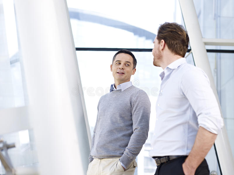 Businessmen talking royalty free stock photo