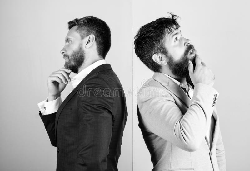 Businessmen thoughtful face thinking about business problem. Business in trouble concept. Business misunderstanding. Business team work on solving problem royalty free stock images