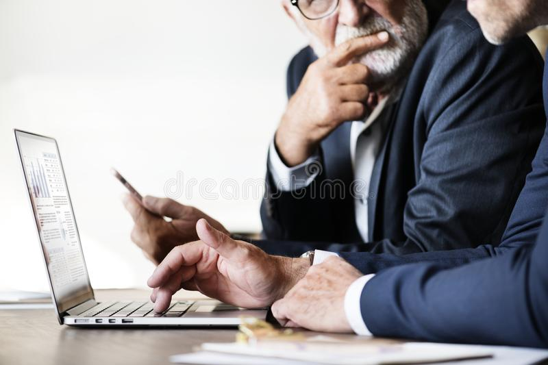 Businessmen using computer laptop working stock images