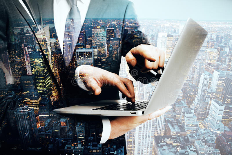 Businessmen using laptop multiexposure stock images