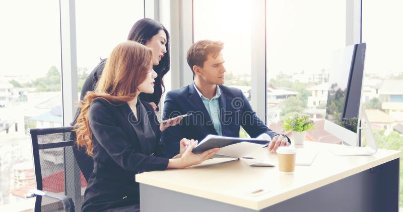 Businessmen and using notebook pc and tablet for discussing documents and ideas in meeting and business serious for working royalty free stock photo