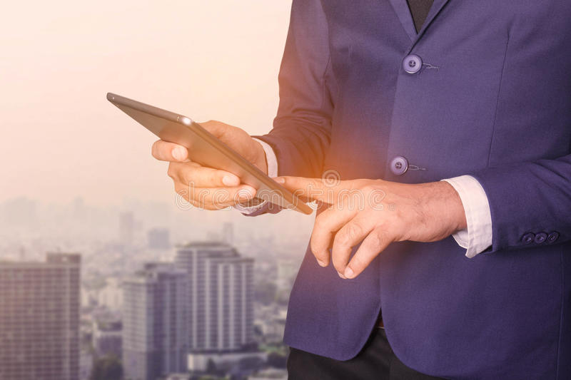 Businessmen are using tablets. royalty free stock image