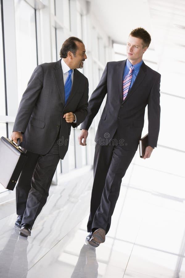Download Businessmen Walking Through Lobby Stock Image - Image: 6080385