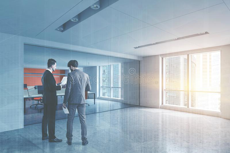 Businessmen in white open space office lobby stock images