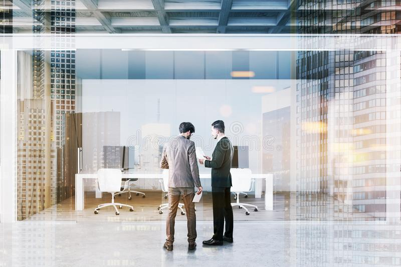 Businessmen in white open space office stock photography