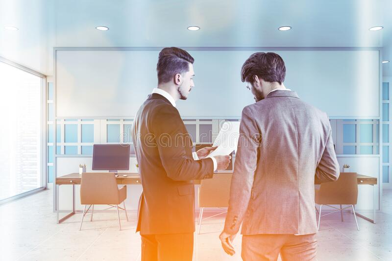 Businessmen in white open space office royalty free stock photography