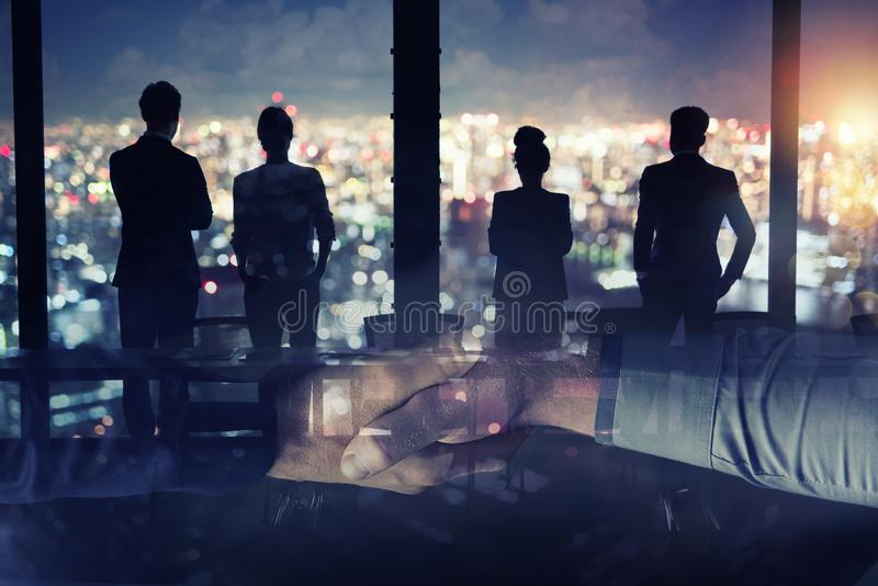 Businessmen that work together in office. Concept of teamwork and partnership. double exposure royalty free stock photos