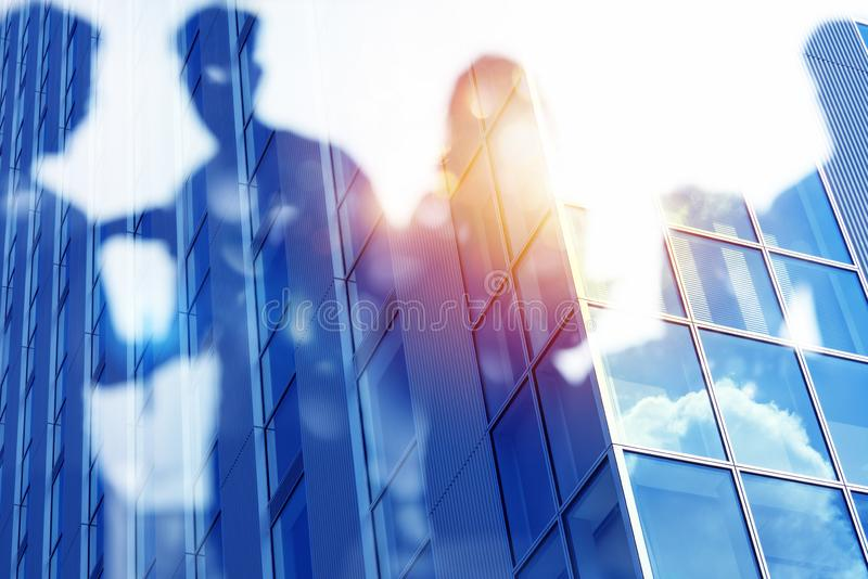 Businessmen that work together in office. Concept of teamwork and partnership. double exposure. Business people work together in office. Concept of teamwork and royalty free stock image