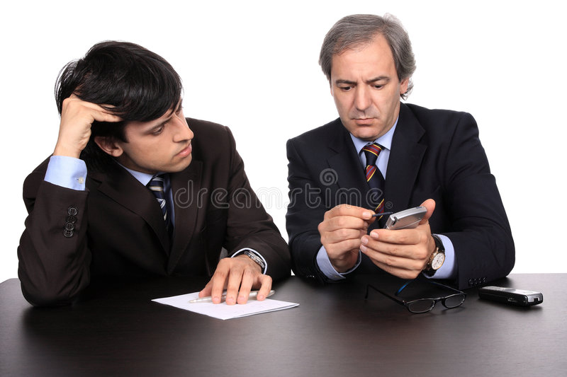 Businessmen working. Two businessmen working at a desk royalty free stock images