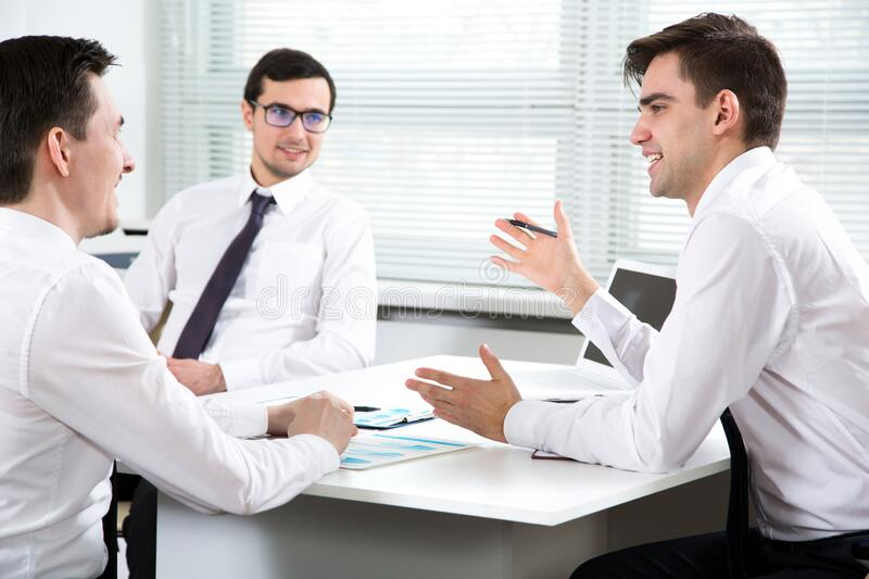 Businessmen working in an office stock photos