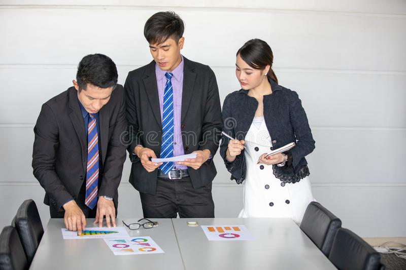 Businessmen working and point on graph financial diagram and analysis documents on office table stock image