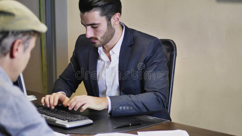 Businessmen working together on projects stock photography