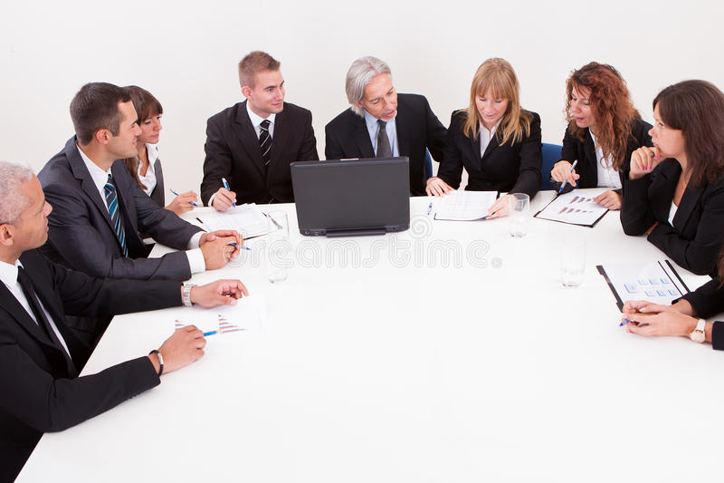 Businesspeople στη συνεδρίαση στοκ φωτογραφία