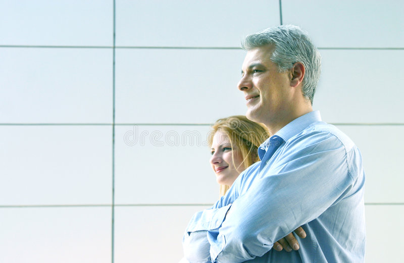 Businesspeople. Portrait of two business colleagues standing together in profile stock images