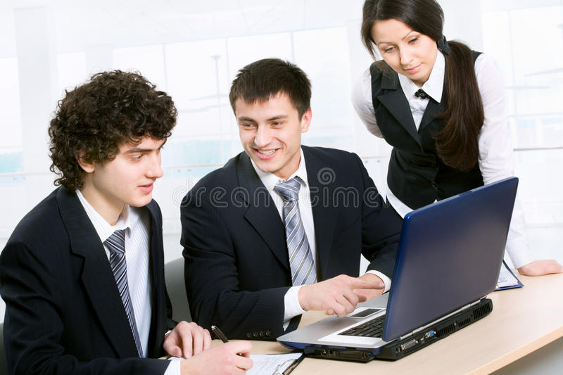 Businesspeople. Business man explaining a new project to colleagues royalty free stock image