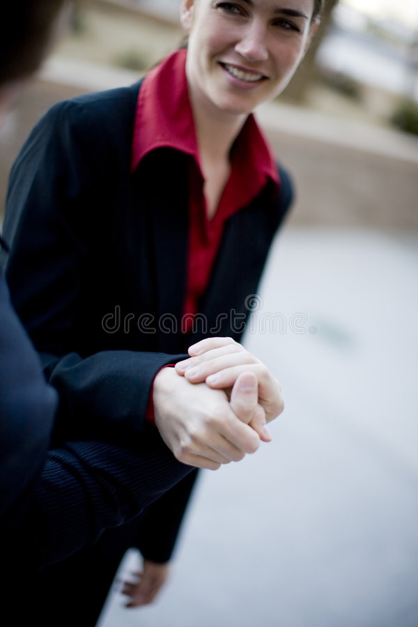 Businesspeople. Businesswoman stands and holds hand of businessman royalty free stock photos