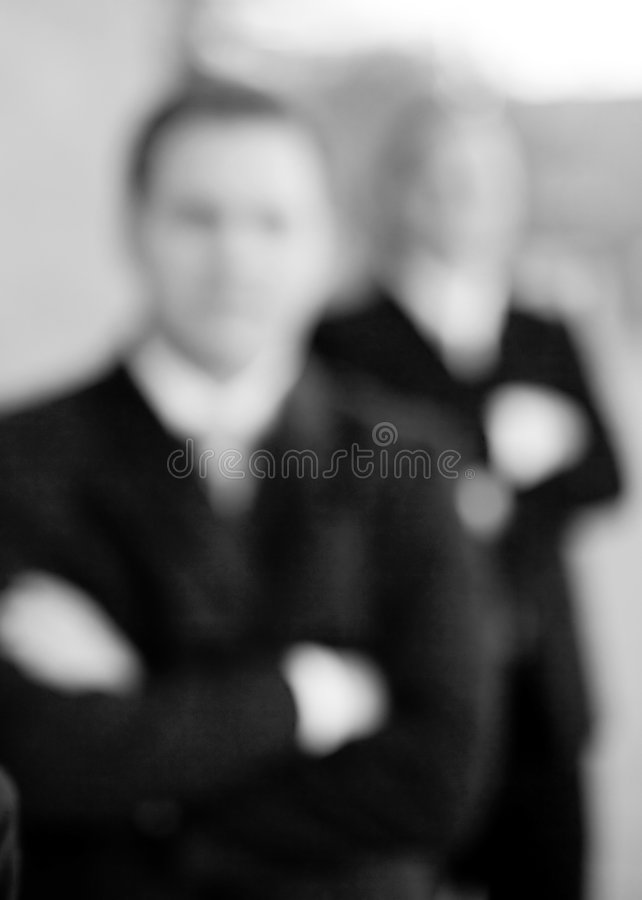 Businesspeople. Businesswoman and businessmen wearing formal wear standing in line smiling royalty free stock photography
