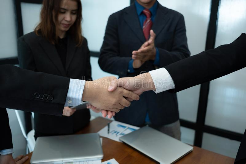 Businesspeople agree to deal business project, businesspeople handshake business contract, business success concept. Businesspeople agree to deal business stock photo