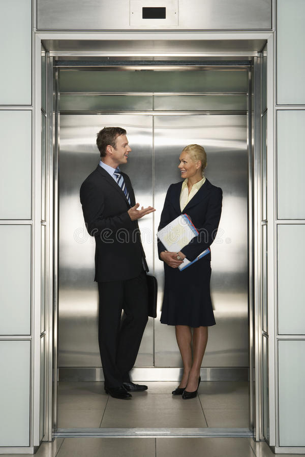 Free Businesspeople Communicating In Elevator Stock Images - 31831604