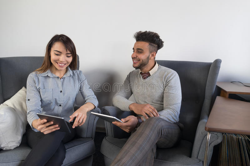 Businesspeople Couple In Coworking Center Diverse Mix Race Business Man And Woman Coworkers Using Tablet Computer royalty free stock photography