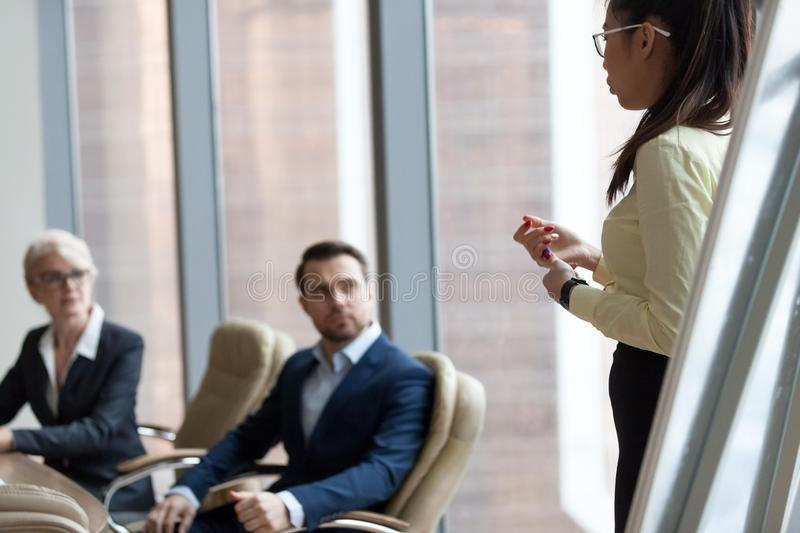 Businesspeople, director or boss listening asian coach woman. Presentation of new project to employees colleagues during briefing. Customer and client meeting royalty free stock photography