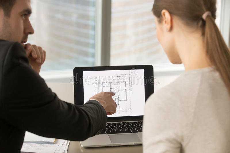 Businesspeople discussing home remodeling, building project plan stock photos