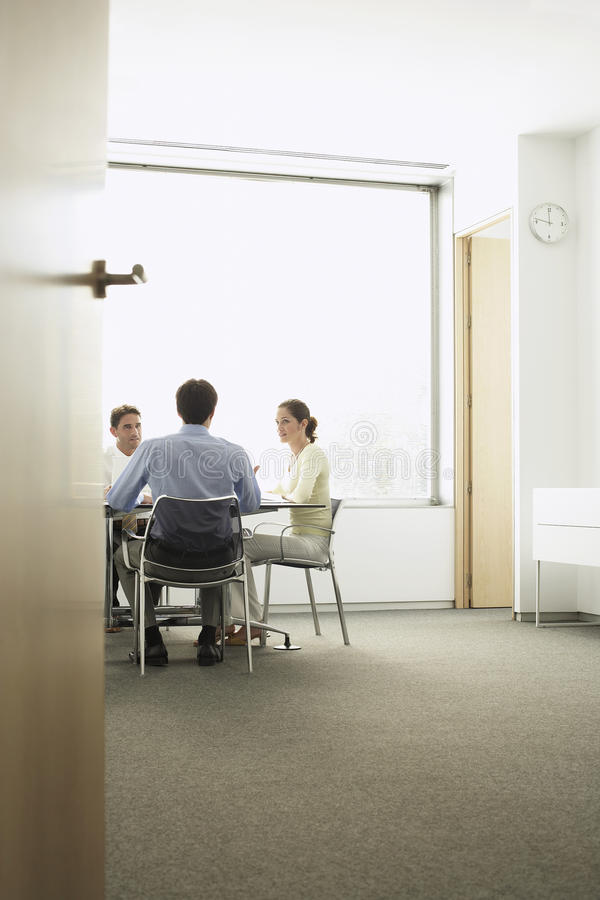 Businesspeople Discussing During Meeting In Boardroom royalty free stock image