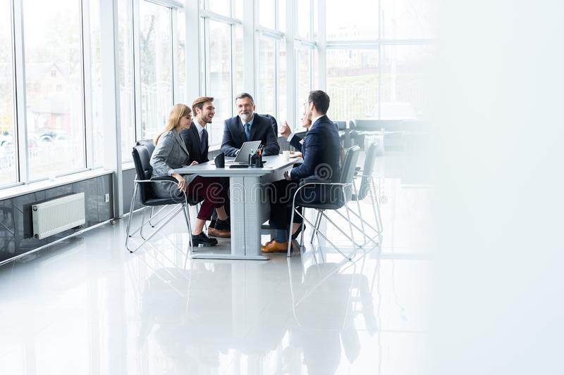 Businesspeople discussing together in conference room during meeting at office. stock image