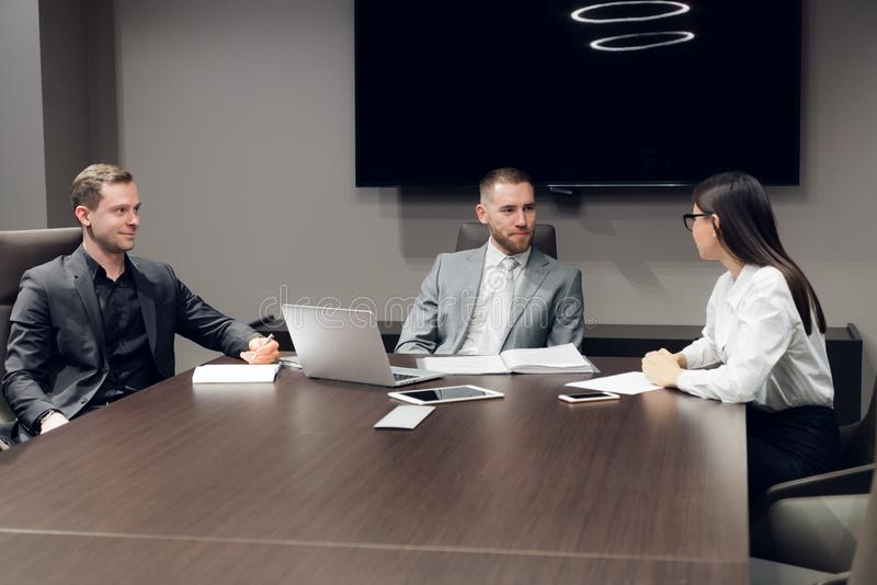 Businesspeople discussing together in conference room during meeting at office stock photography