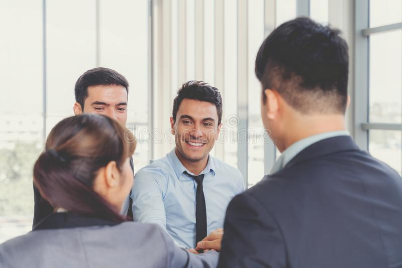 Businesspeople discussing together in conference room during meeting at office royalty free stock photography