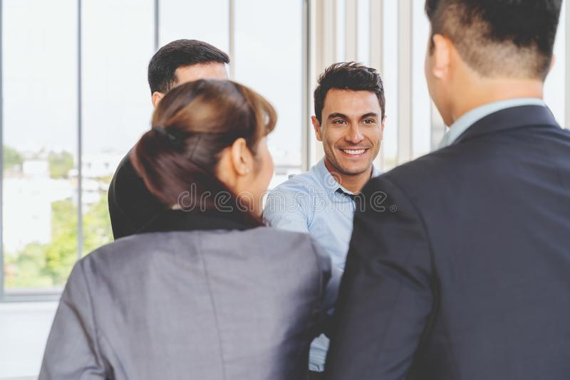 Businesspeople discussing together in conference room during meeting at office royalty free stock photo