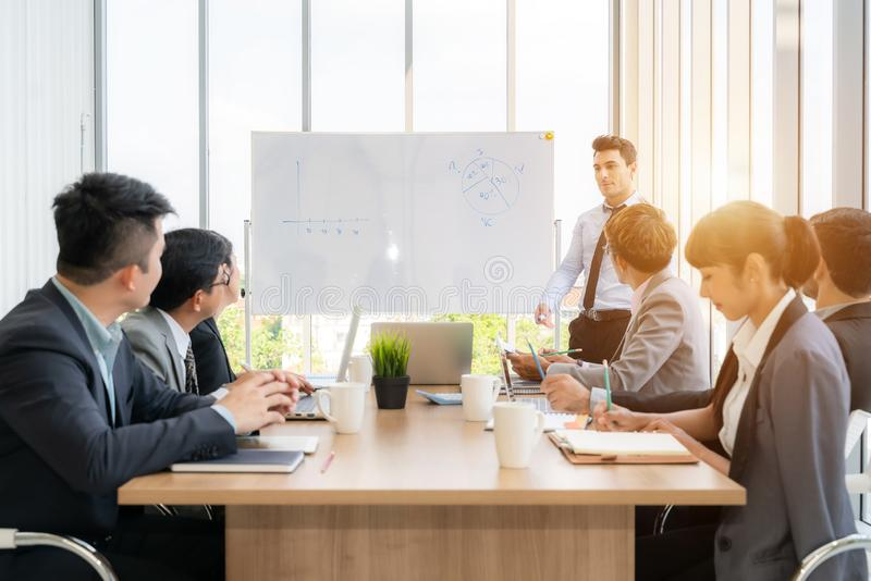 Businesspeople discussing together in conference room during meeting at office stock images
