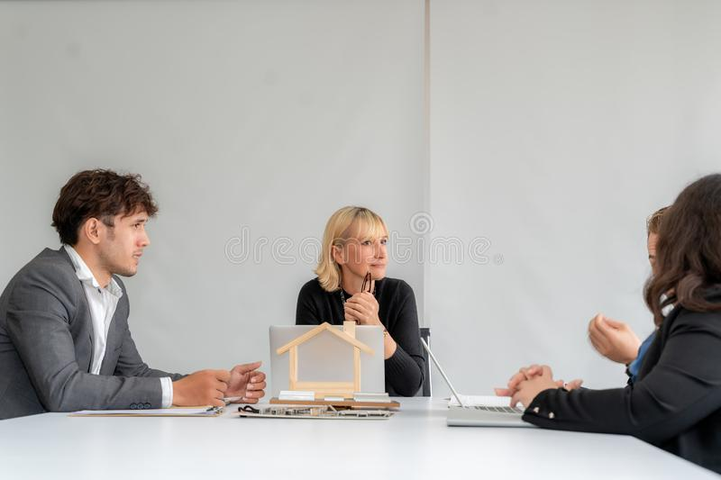 Businesspeople discussing together in conference room during meeting at office stock photo