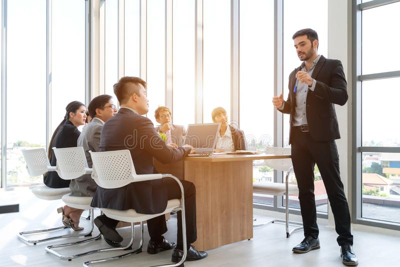 Businesspeople discussing together in conference room during meeting at office royalty free stock images