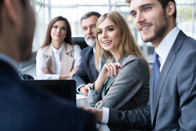 Businesspeople discussing together in conference room during meeting at office. stock photos