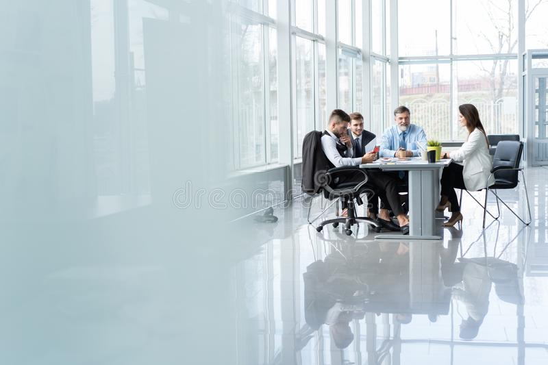 Businesspeople discussing together in conference room during meeting at office. royalty free stock image