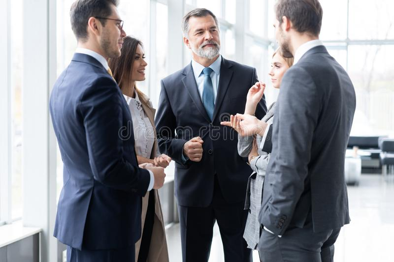 Businesspeople discussing together in conference room during meeting at office. stock photo