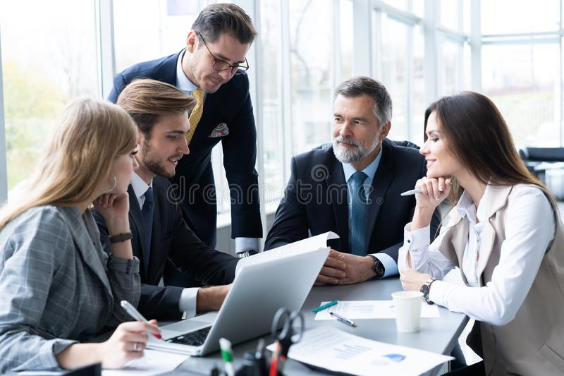 Businesspeople discussing together in conference room during meeting at office. royalty free stock images