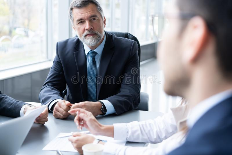 Businesspeople discussing together in conference room during meeting at office. royalty free stock photos
