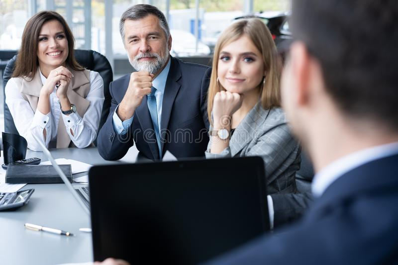 Businesspeople discussing together in conference room during meeting at office. royalty free stock photography