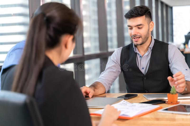Businesspeople discussing together in conference room during meeting at office royalty free stock photos