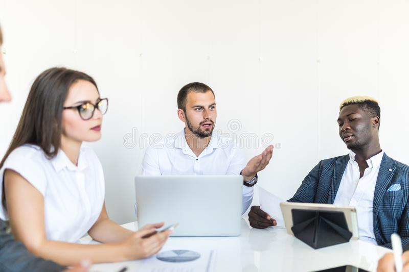 Businesspeople discussing together in conference room during meeting at office. Team work royalty free stock image