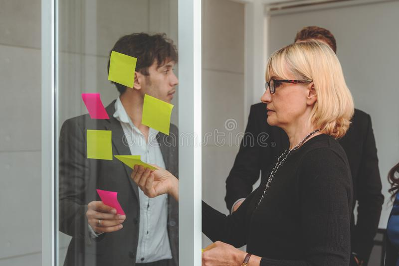 Businesspeople discussing together in conference room during meeting at office royalty free stock image