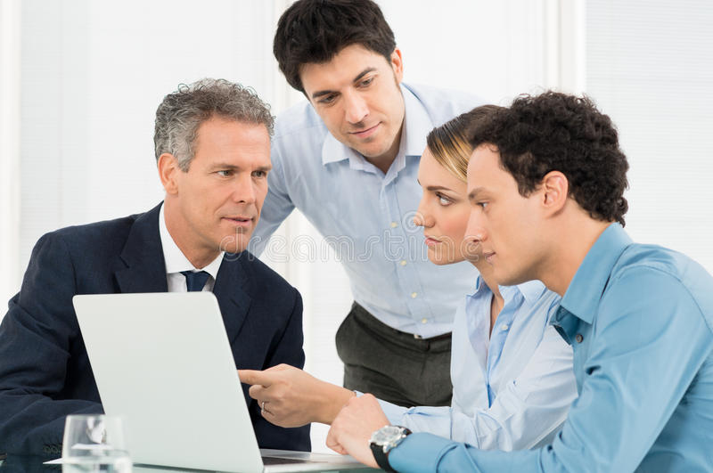Businesspeople Discussing Together stock images