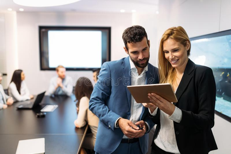 Businesspeople discussing while using digital tablet in office stock photos