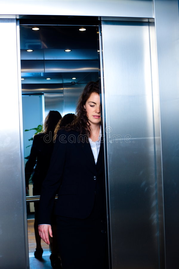 Businesspeople In Elevator Royalty Free Stock Photo