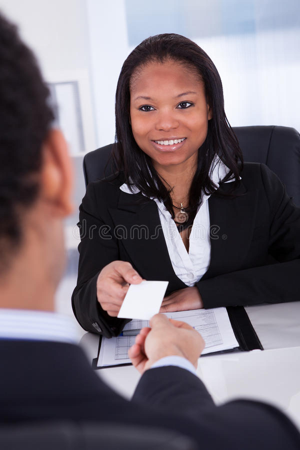 Businesspeople exchanging visiting card royalty free stock images